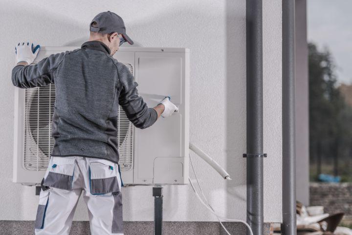 Service Technician Replacing Heat Pump